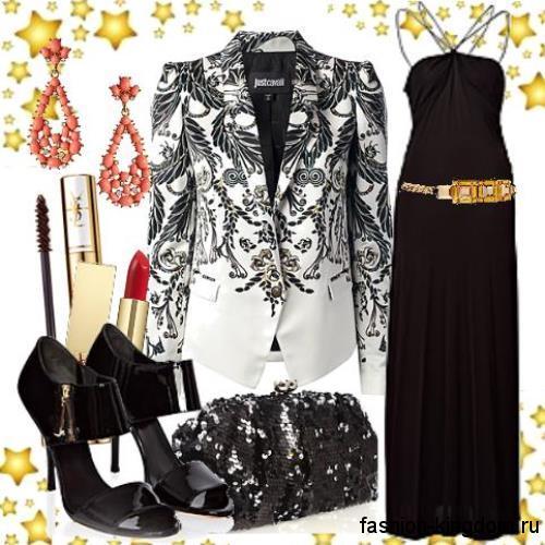 Платье черного цвета в вечернем стиле, длиной в пол, декорированное золотистым поясом в тандеме с черно-белым пиджаком и открытыми черными туфлями на каблуке.