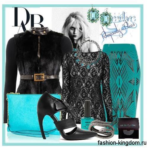 Юбка-карандаш бирюзового цвета с геометрическим принтом для вернего стиля, длиной до колен в сочетании с кружевной черной блузкой, меховым жакетом и бирюзовой сумочкой.