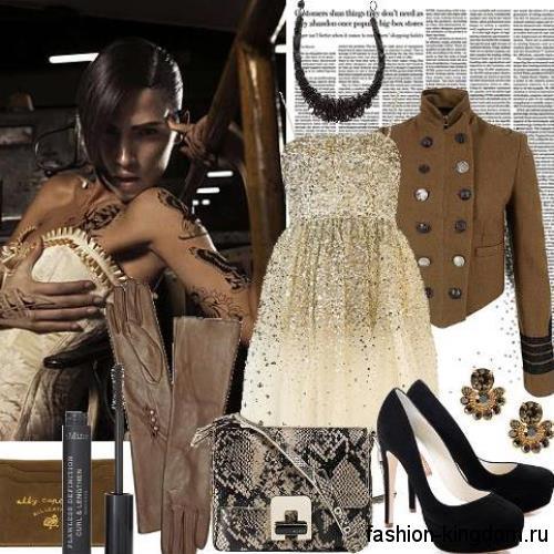 Короткое платье молочного оттенка с пышной юбкой и корсетным верхом, декорированное золотистым бисером и пайетками, в тандеме с жакетом в стиле милитари и черными туфлями.
