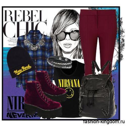 Рубашка в клетку черно-синего цвета дополняет узкие брюки бордового оттенка, черной футболкой и массивными ботинками.