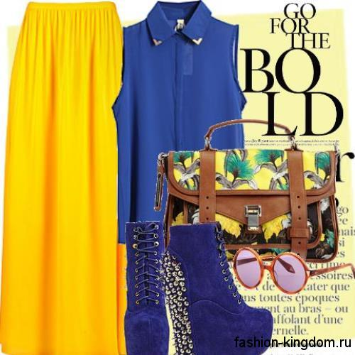Юбка макси желтого цвета прямого силуэта гармонирует с шифоновой блузкой синего тона без рукавов.