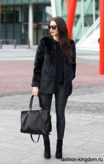 Узкие черные брюки и шуба черного цвета для цветотипа внешности зима.