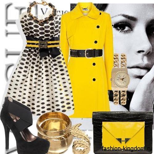 Осеннее пальто желтого цвета, длиной до колен, приталенного силуэта, дополняется широким черным поясом.