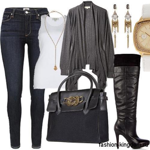Тонкий кардиган серого цвета, средней длины, асимметричного кроя в сочетании с узкими темно-синими джинсами.