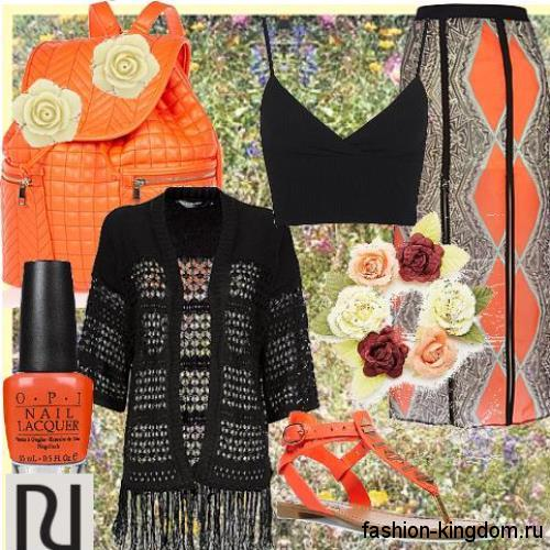 Ажурный кардиган черного цвета, средней длины в сочетании с коротким топом и юбкой-мди серо-оранжевого тона.
